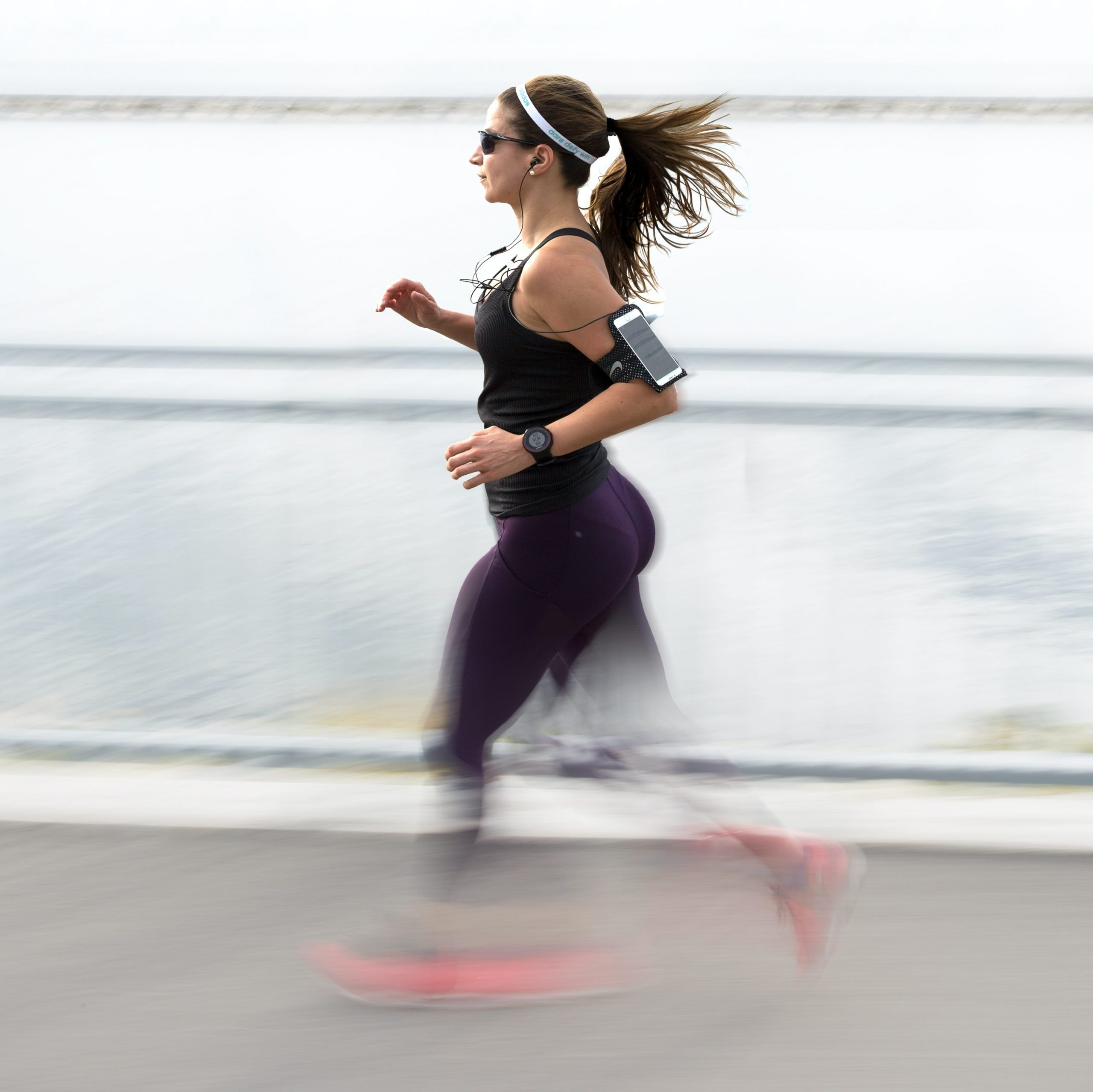 Woman running outdoors with music